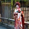 A tourist or a geisha? Most likely a tourist dressed up like a geisha to take a late afternoon stroll in Gion, Kyoto