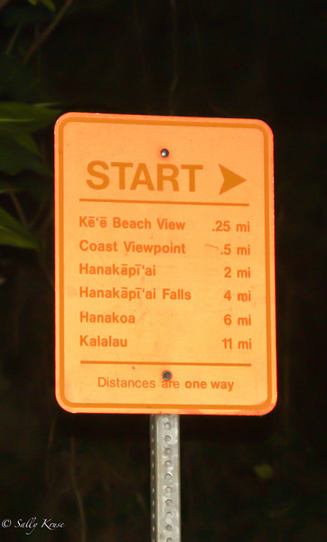 Distance sign at the trailhead of the Kalalau Trail, Na Pali coast, Kauai, Hawaii