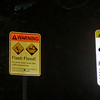 Warning signs at the trailhead of the Kalalau Trail, Na Pali coast, Kauai, Hawaii