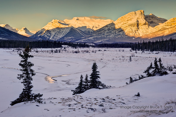 Sunlight on the peaks.<br /> <br /> The view looking west along the North Saskatchewan River valley towards the peaks that were illuminated by the January sunrise.