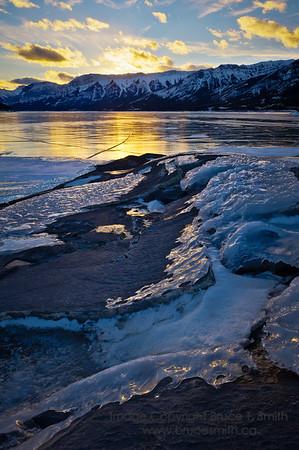 Frozen sunset over Abraham Lake