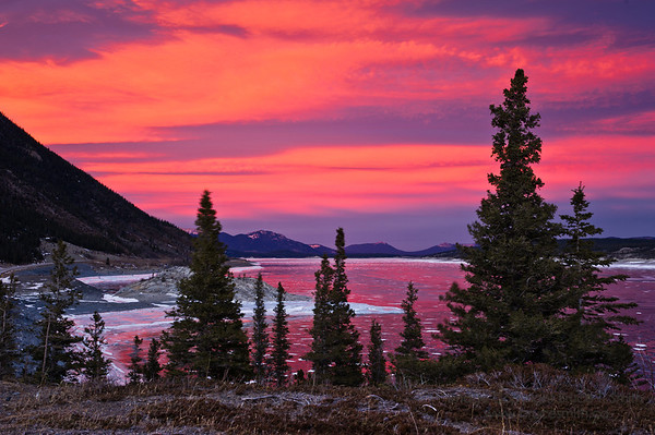 Amazing underlit sunset clouds and reflection at Abraham Lake.