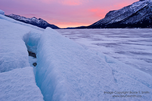Sunrise over the ice of Abraham Lake