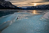 Icy sunset over Abraham Lake in February.