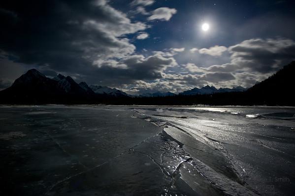 Moonlight shining on the ice of Abraham Lake.