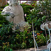 Rajalila asana Buddha (royal ease)  in a peaceful garden surrounded by goldfish pond.