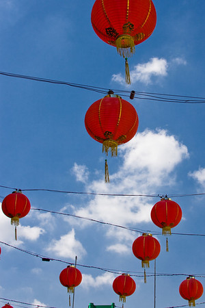 Lanterns float high above in the Southern California sun.