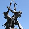 Metal statue of Native American Indians playing La Crosse.