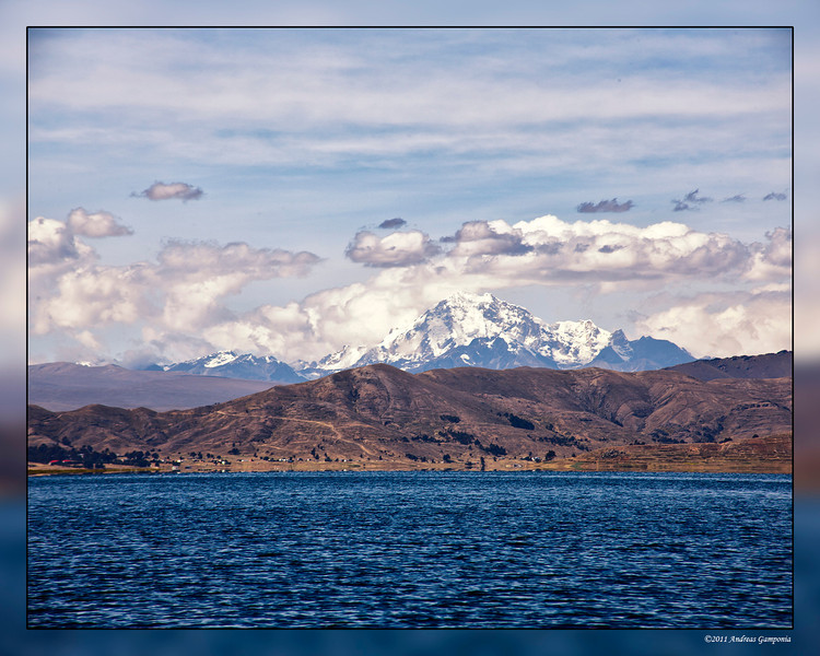 Lago Titticaca, on the border between Bolivia and Peru is the highest commercially navigable lake in the world and sits at an altitude of 12,500 feet.  In the background is what I believe is Mount Chachacomani climbing to an altitude of 19,928 feet.