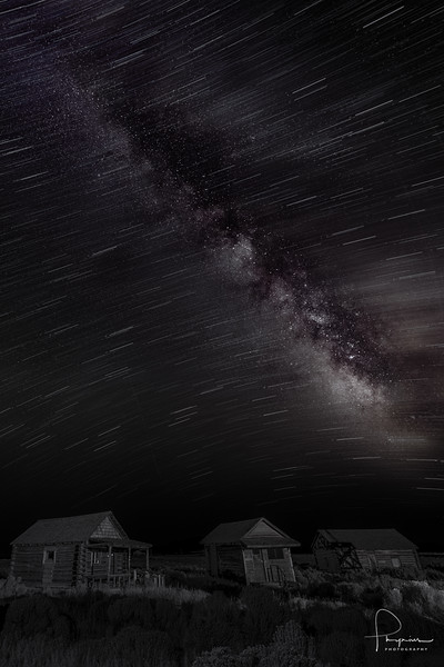 """""""The warping of space and time"""" ~ This image is a composite of a time lapse shot for the star trails and a static shot for the detail in the foreground and galaxy. This is truly a warp on multiple levels. Modern photographic equipment, old style processing. Static and time lapse. Shot last weekend with frontier era homes in the foreground. Color and B/W. This image respects nothing. You like or not? Comments and critiques welcome."""