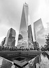 Overcast day at the WTC Memorial.  The Freedom Tower overlooking the Memorial Pools.   Photos by:  @RickBeldenPhotography   .................