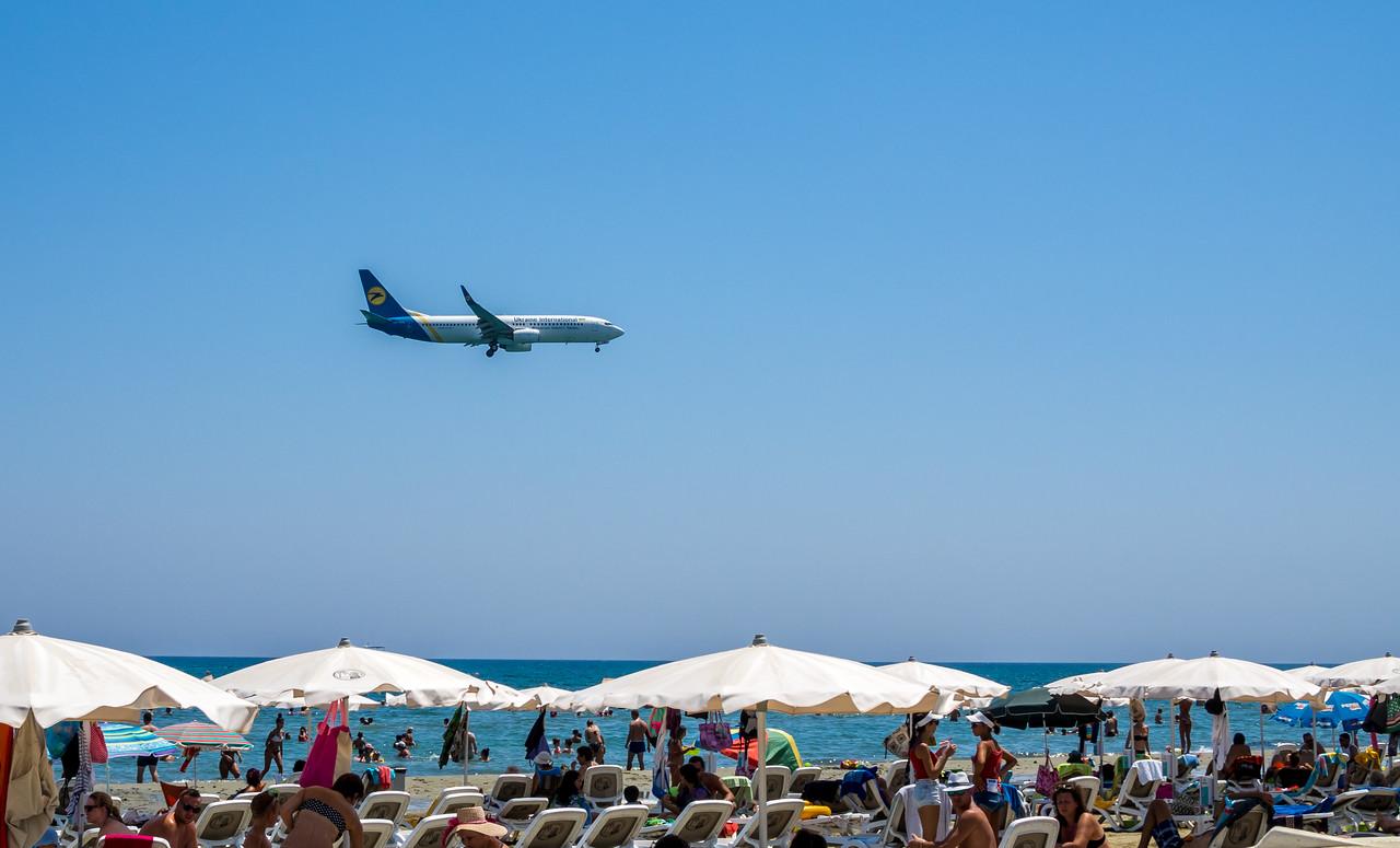 Plane landing over McKenzie beach