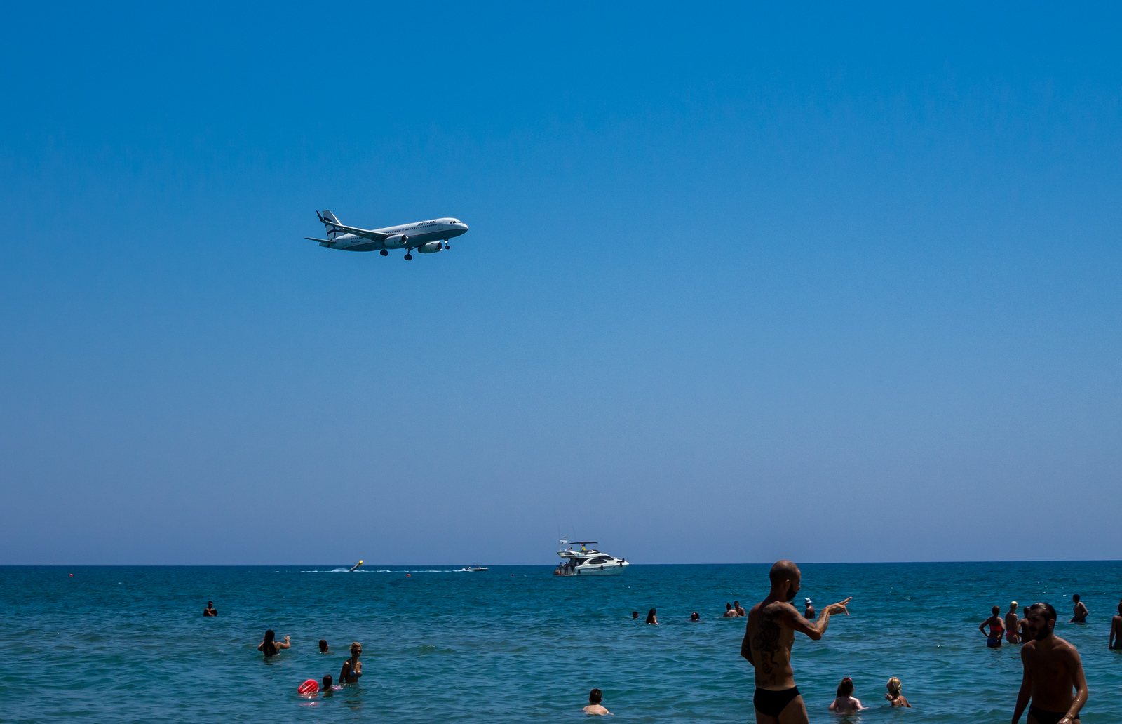 Plane landing over McKenzie beach