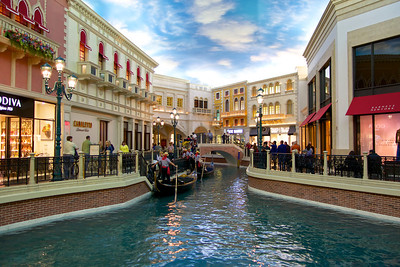 Gondoliers take a break on the Grand Canal. The Venetian hotel
