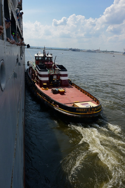 Tugboat nudges us into position.