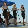 The Manhattan Dolls motioning me to hand over my telephoto lens.