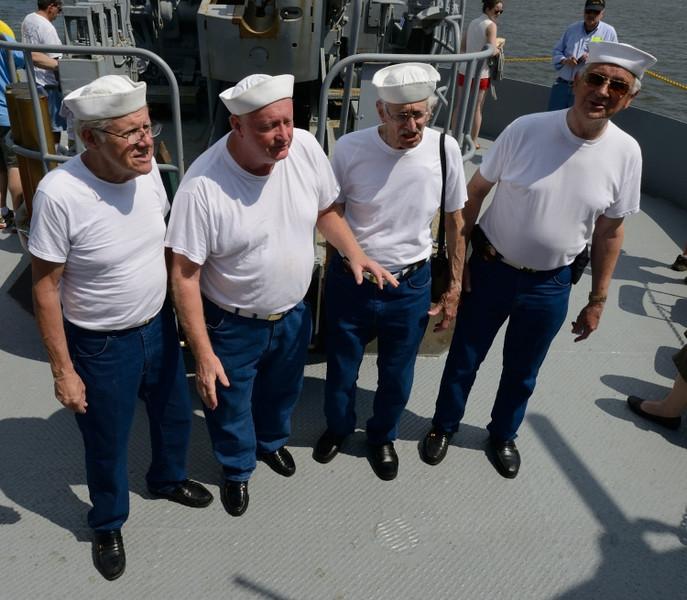 Barbershop Quartet performs at ship's stern.