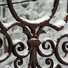 I love the white of the snow against the rust of the old gates.
