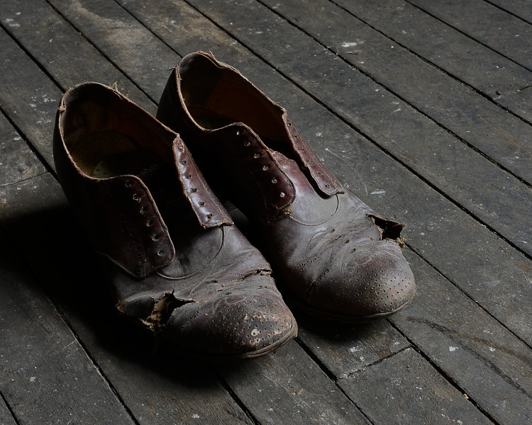 Pair of old shoes up on the third floor.