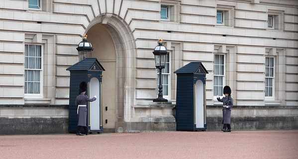 Guards marching at Buckingham Palace.
