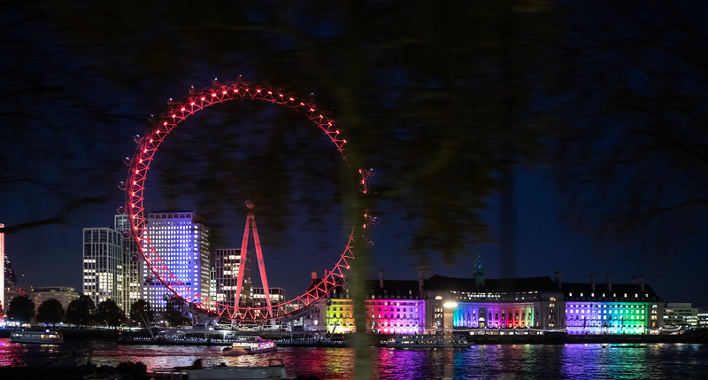 The London Eye and the County Hall building at night.