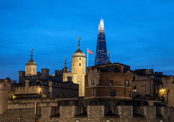 The Tower of London (foreground) was the tallest building in England/Europe for many years. The Shard (background) is the current tallest building in England/Europe.