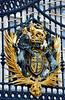 Royal Emblem on the gates of Buckingham Palace - London, England