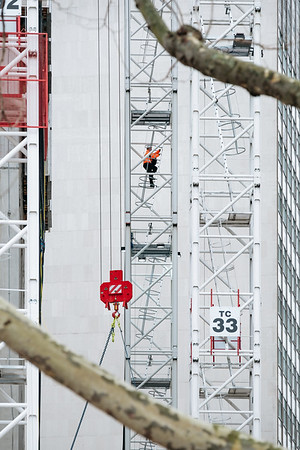 Climbing on a crane in London