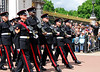 Uniformed soldiers walking in step at the Changing of the Guards - <br /> Buckingham Palace - London, England