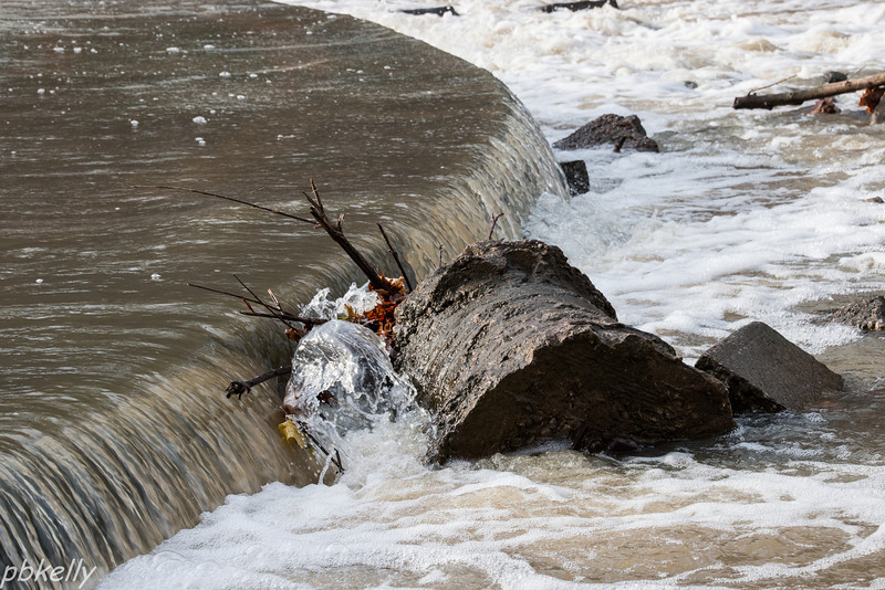 11/20/13.  Log got jammed in this small spillway.