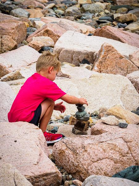 Gray making Rock Cairns