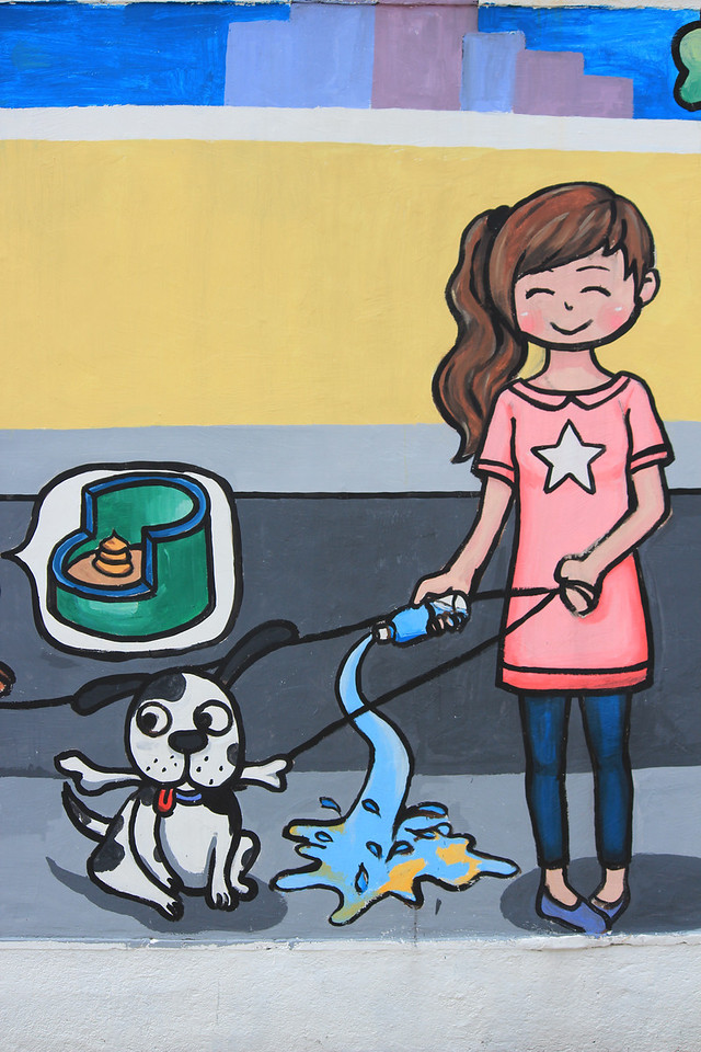 Mural in Macau asking visitors not to let their dogs defecate in public