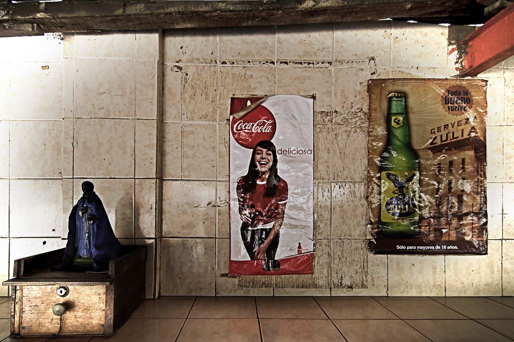 Three things deeply ingrained in the life of the people from Maracaibo: San Benito, Coca-Cola & beer (local Zulia beer is back!). Folks are very proud to say the first Coca-cola factory in the country was established in Maracaibo and probably the same happened with the beer ...<br /> <br /> This photo was taken at a popular fried fish (look at that photo) eating place in the outskirts of the city ...