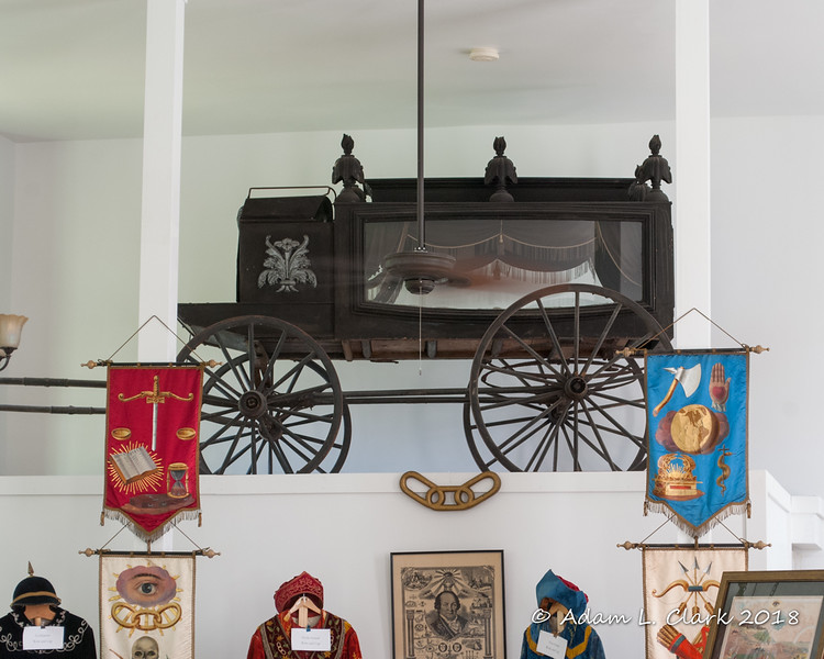 The old summer hearse.  A horse drawn wagon with glass sides for viewing of the casket