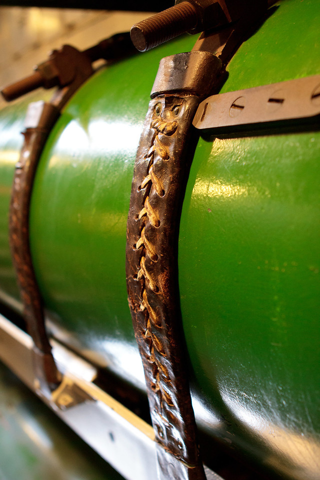 Leather straps are what hold the torpedoes in place. - Battleship Cove in Fall River, Massachusetts. April 2012.