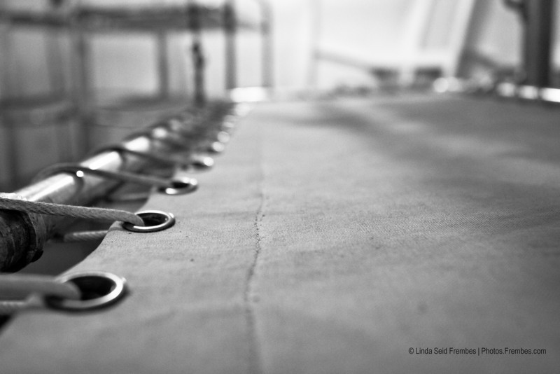 Close-up of a cot. Looks (not very) comfy. - Battleship Cove in Fall River, Massachusetts. April 2012.