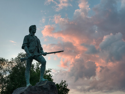 16 July 2013.  Minuteman statue and sunset in Lexington, MA.