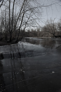 20130127. Concord River in Minute Man NHP.  The river has gone down after being frozen so the ice slopes down into the river.