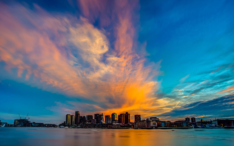 Epic Sunset Over Boston  It was a very interesting moment. It was all heavy rain clouds over Boston. And to the right was an amazing sunset. But all of a sudden the clouds started to rib and create what I call an epic sunset. I can say I was very lucky with this one!   Canon 5D MK III Canon 17040mm f/4 L ISO 50 f/22 5 Shot Fusion Blend in Photomatix Prints - http://smu.gs/O31rFD  #photospot  (GPS: 42.369464,-71.044583)