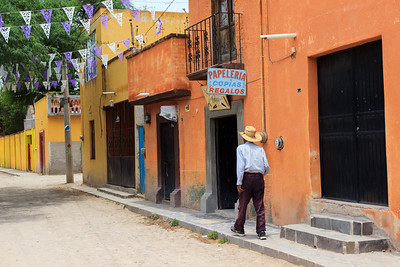 Man walking down side street, Mexico