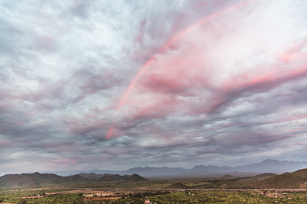 This unusual pink rainbow was in the eastern sky, essentially reflecting the sunset.