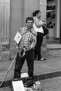 Blind man selling candy, Mexico