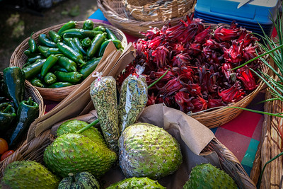 Jalapenos, hibiscus, herbs and pears at the Mercado Organico