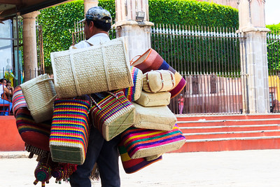 Man selling baskets in the square, Mexico