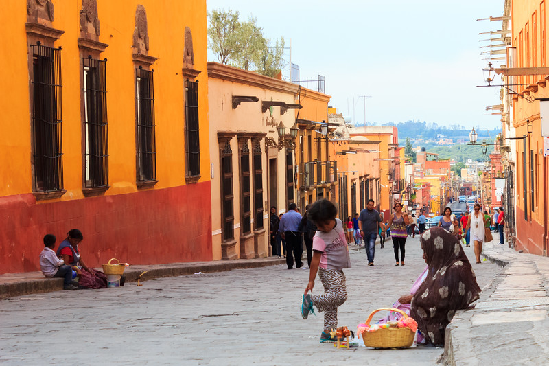 Old woman and child selling handmade toys on the street, Mexico