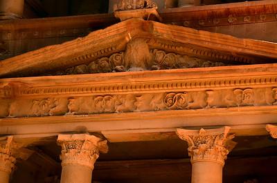 Detail view of the lintel at the entrance to Al Khazneh in Petra, Jordan.