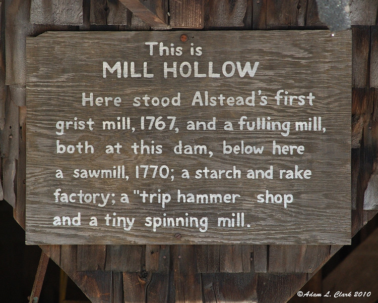 Mill Hollow sign on the building