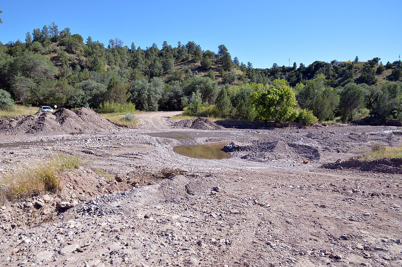 The low-water crossing of usually-dry Mineral Creek. The county's bulldozer was making good progress.