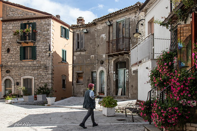 Section of a square in Frosolone, illustrating well kept up and abandoned buildings side by side in this depopulated area of Italy.