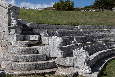 Detail from the amphitheater.  The stone seats were for  those with status.  There were wooden bleachers continuing up the hill for the lesser folk.
